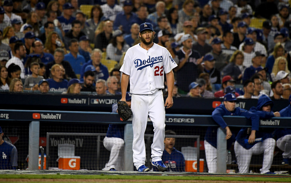 Starting pitcher Clayton Kershaw of the Los Angeles Dodgers reacts after J.D. Martinez ( not pictured) of the Boston Red Sox solo home run in the seventh inning of game five of the World Series at Dodger Stadium on Sunday, October 28, 2018 in Los Angeles, California.