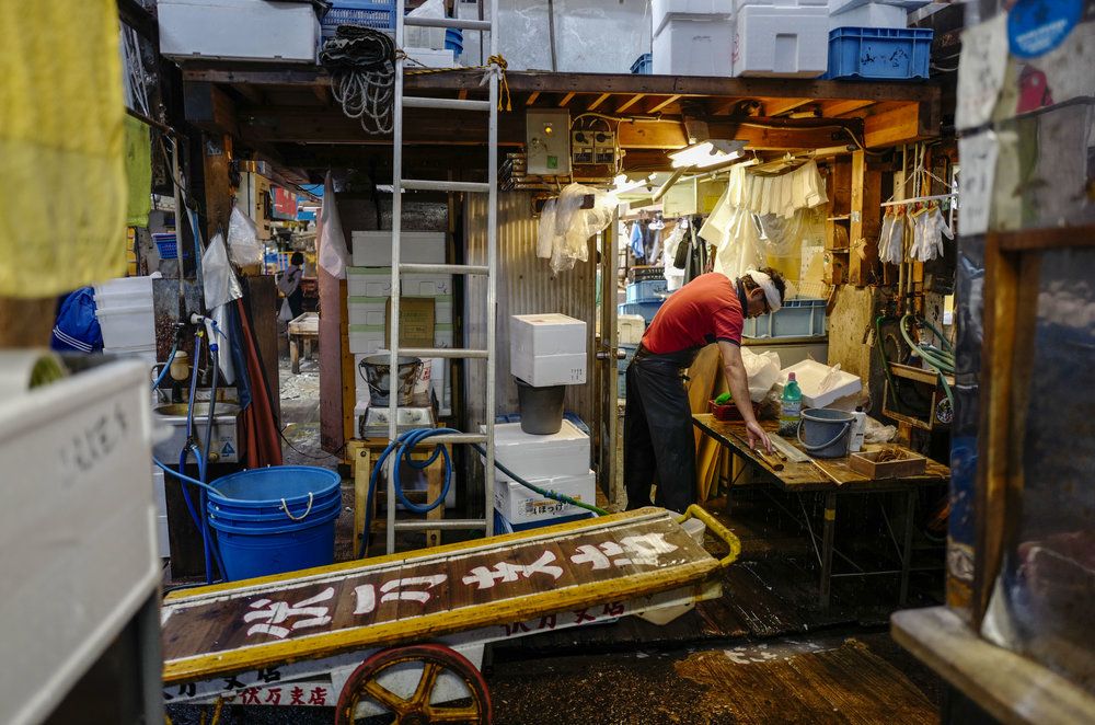 A wholeseller cleans up his store in Tsukiji fish wholesale market during its final day of operations ahead of relocation to the nearby Toyosu waterfront district, in Tokyo on Oct. 6, 2018. The world's largest fish market, which has been in operation for 83 years, is being moved as part of the redevelopment for the 2020 Olympic Games.