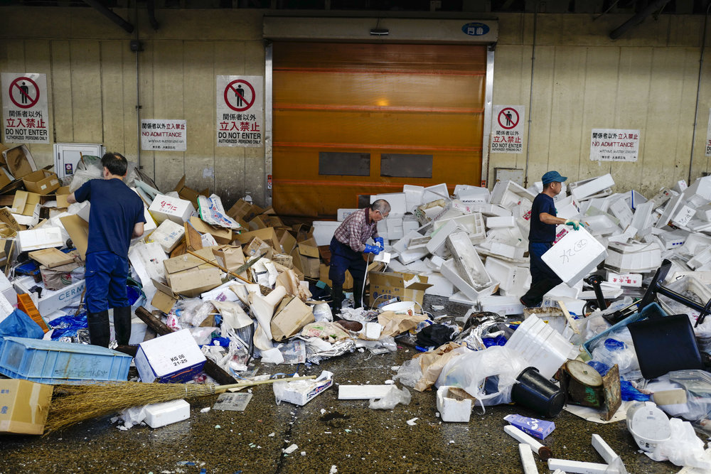 Wholesellers clean up their store in Tsukiji fish wholesale market during its final day of operations ahead of relocation to the nearby Toyosu waterfront district, in Tokyo on Oct. 6, 2018. The world's largest fish market, which has been in operation for 83 years, is being moved as part of the redevelopment for the 2020 Olympic Games.