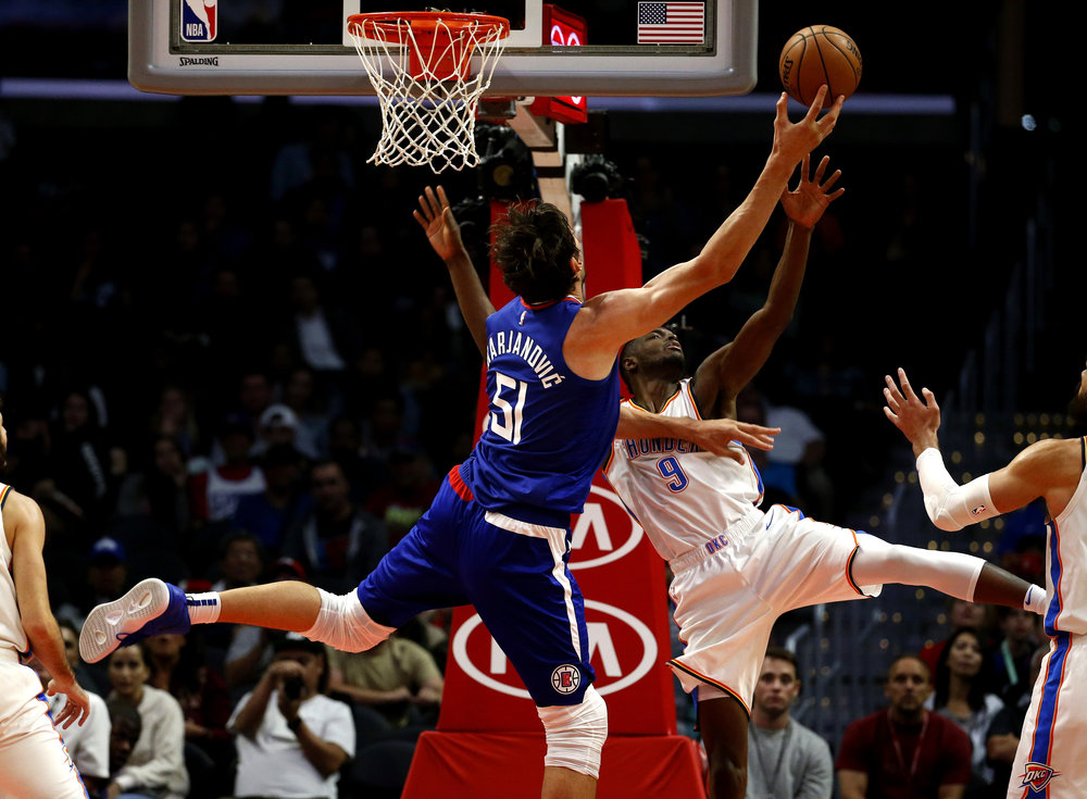 Los Angeles Clippers' Boban Marjanovic (51) goes up to the basket agains Oklahoma City Thunder's Jerami Grant (9) during the second half of an NBA basketball game Friday, Oct. 19, 2018, in Los Angeles. Clipper won 108-92.