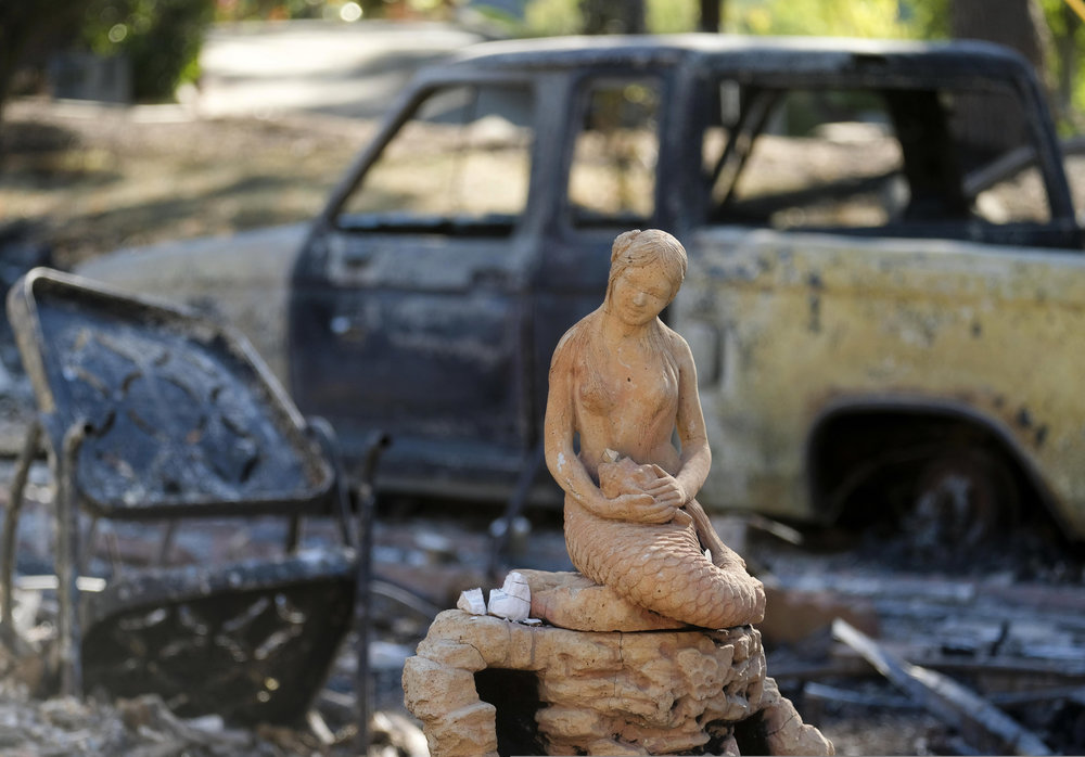 A statue sits at the charred remains of a burned out home  in Malibu, California, on November 14, 2018.
