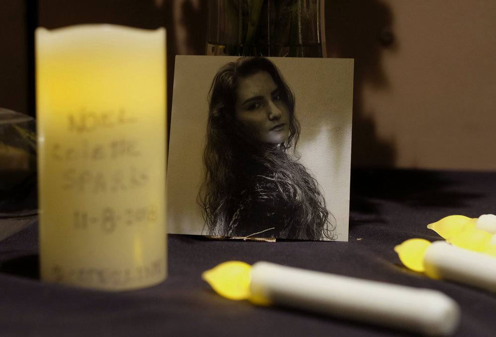 A picture of one of victims of the mass shooting is seen during a candlelight vigil in Thousand Oaks , Calif., Thursday, Nov. 8, 2018. A gunman opened fire Wednesday evening inside a country music bar, killing multiple people including a Sheriff officer.