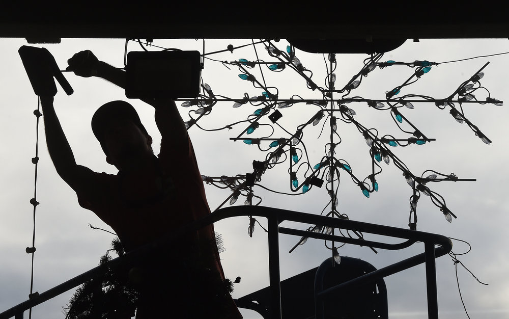 Steve Sanchez puts the finishing touches on the Jolly Holiday Village in the fan zone at Auto Club Speedway in Fontana, Thursday, November 15, 2018. The Jolly Holiday Village is a new addition this season for the Magic of Lights drive through tour at the Speedway. Families can stop at the village, visit Santa, drop off letters to Santa, watch classic holiday movies and other activities. The cost is $20 per vehicle and begins at dusk Friday.
