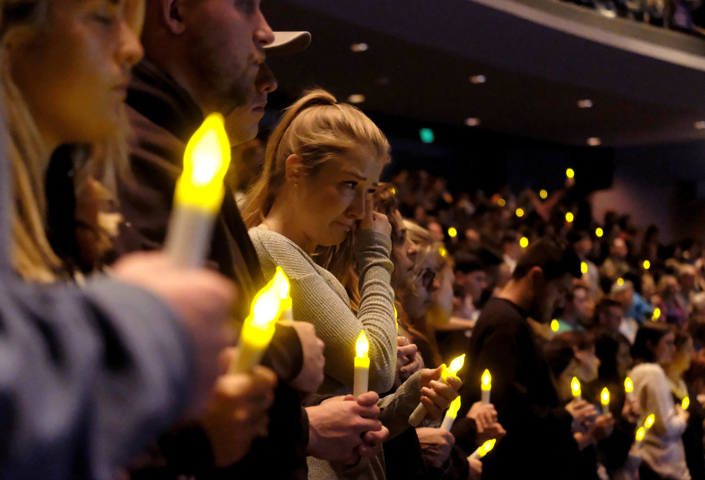 People gather to pray for the victims of the mass shooting during a candlelight vigil in Thousand Oaks , Calif., Thursday, Nov. 8, 2018. A gunman opened fire Wednesday evening inside a country music bar, killing multiple people including a Sheriff officer.