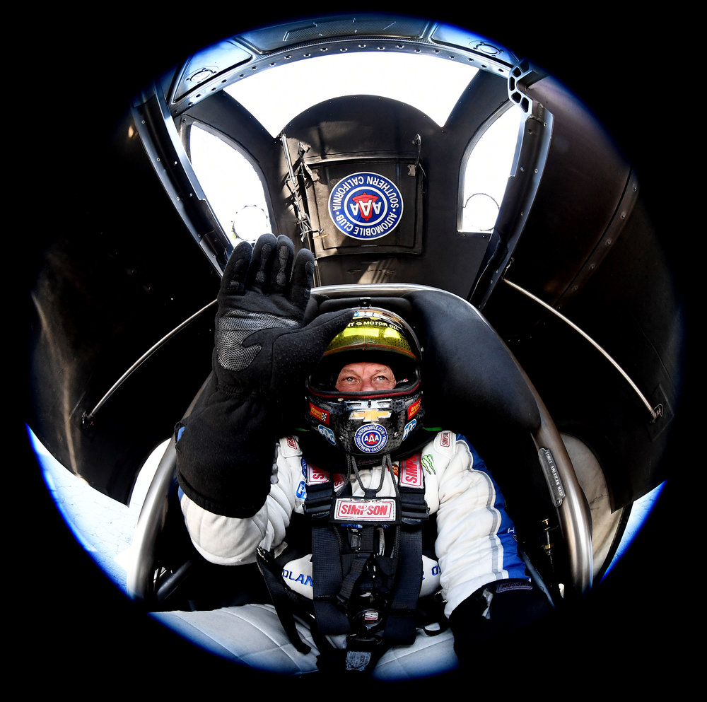 Funny Car driver John Force sits in his hot rod prior to qualifying in Pomona on Friday, November 9, 2018 at the 54th annual NHRA Finals at Auto Club Raceway at Pomona. Pro qualifying continues Saturday.