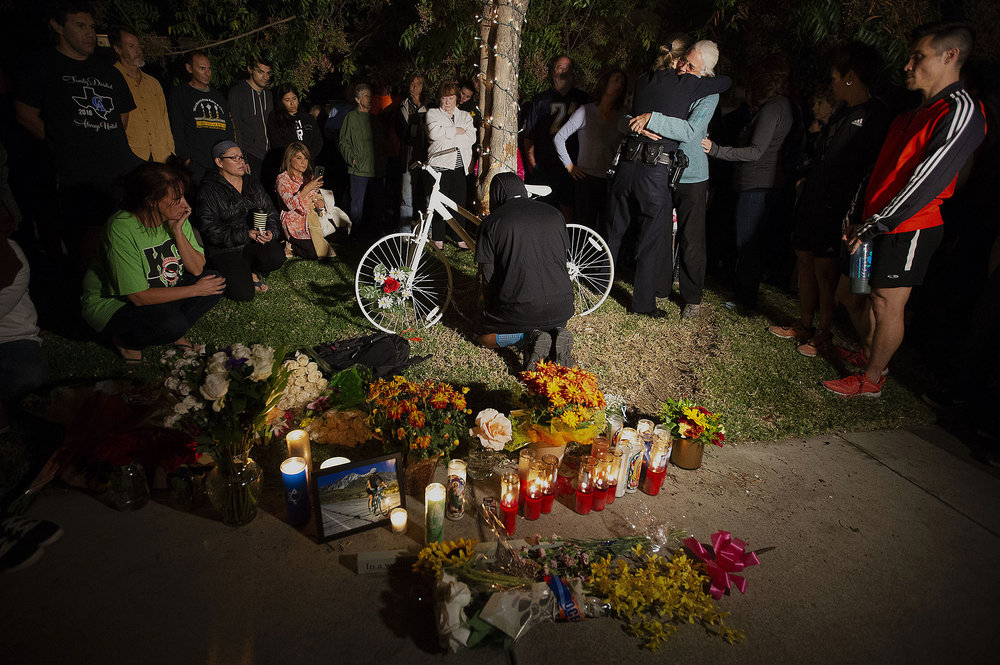 Claremont Chief of Police Shelly Vander Veen hugs Betsy Hipple, life partner of Leslie Pray, 54, who was killed Saturday while riding her bike along Mills Avenue near Radcliffe Drive, as a ghost bike in placed during a candle light vigil to honor Pray in Claremont on Monday, November 5, 2018.