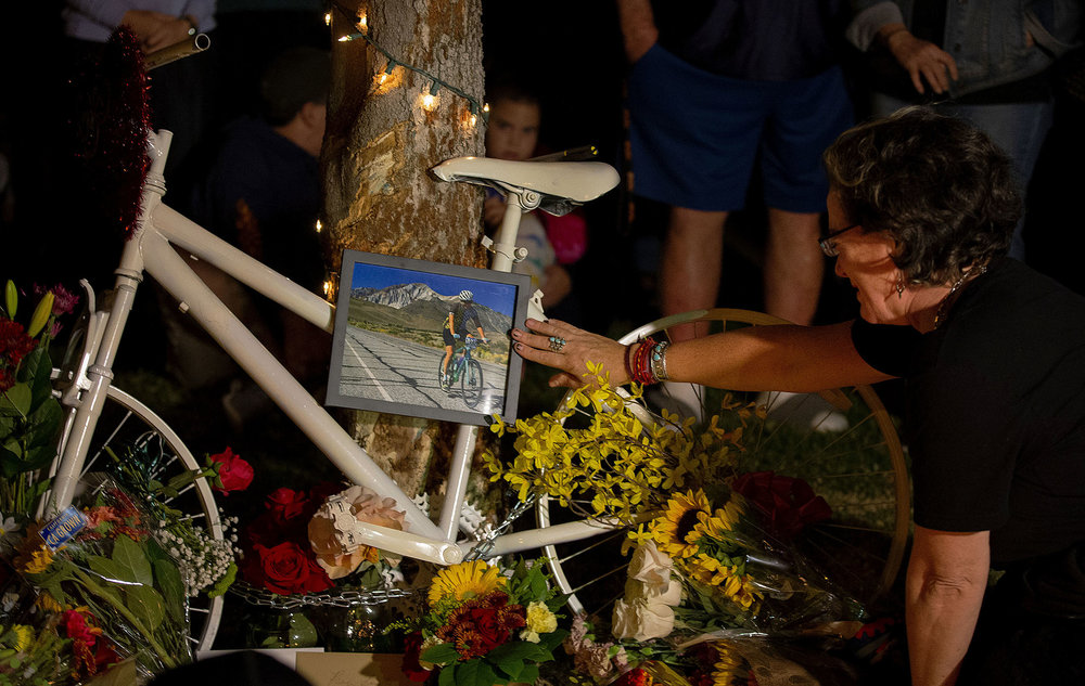 Emotions were high as some friends and family cried while touching the ghost bake place in honor of Leslie Pray, 54, who was killed Saturday while riding her bike along Mills Avenue near Radcliffe Drive, during a candlelight vigil in Claremont on Monday, November 5, 2018.