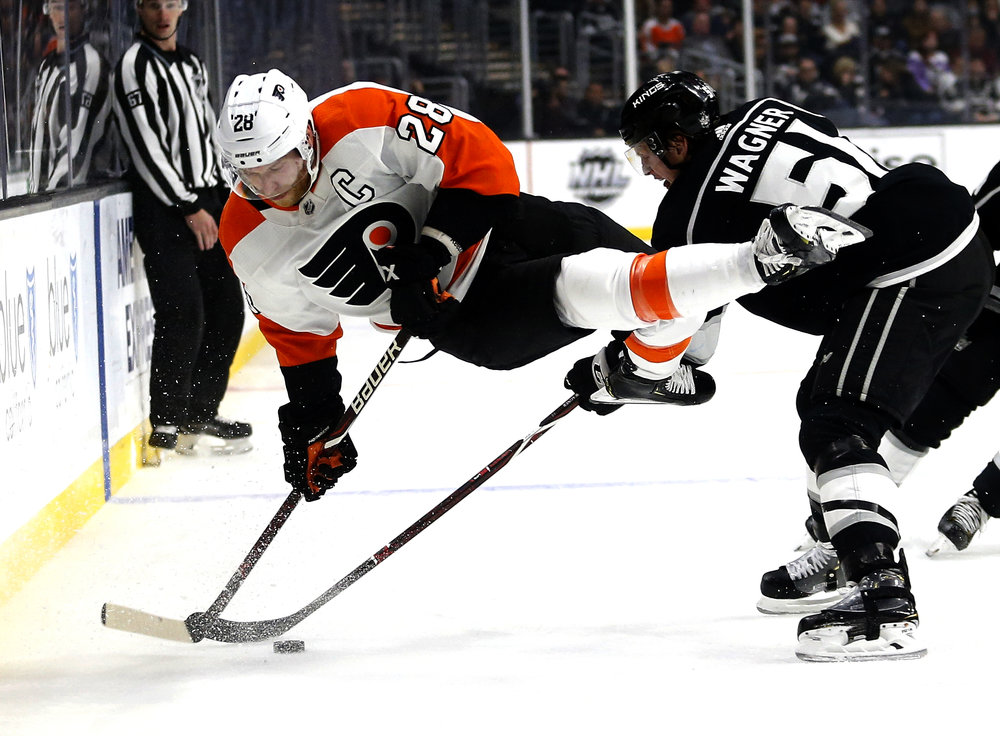 Philadelphia Flyers forward Claude Giroux (28) and Los Angeles Kings forward Austin Wagner (51) vie for the puck during the second period of an NHL hockey game Thursday, Nov. 1, 2018, in Los Angeles.