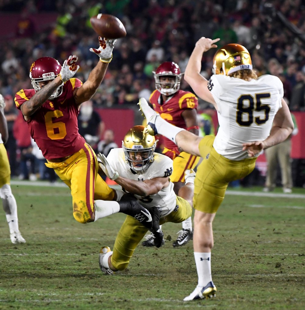 Cornerback Isaac Taylor-Stuart #6 of the USC Trojans gets a hand on the punt by Punter Tyler Newsome #85 of the Notre Dame Fighting Irish in the second half of a NCAA football game at the Los Angeles Memorial Coliseum on Saturday, November 24, 2018 in Los Angeles, California. Notre Dame Fighting Irish won 24-17.
