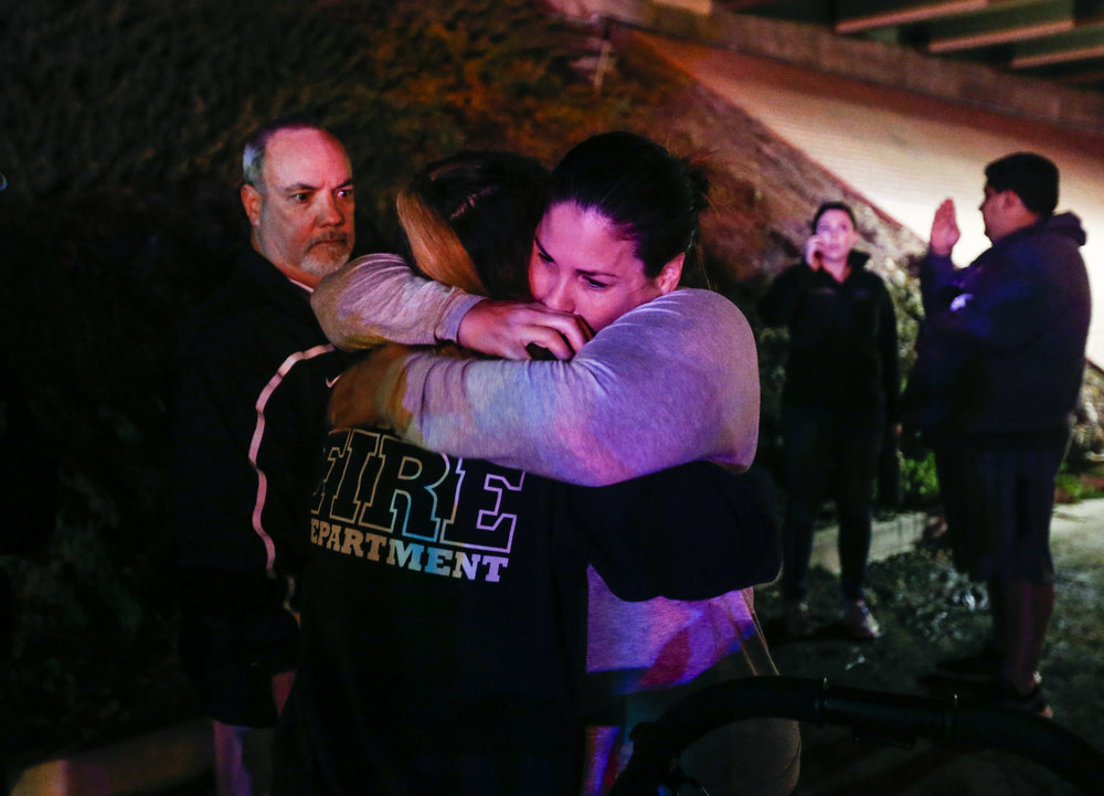 Witnesses comfort each other outside the Borderline Bar and Grill where a gunman injured 11 people in Thousand Oaks, California, the United State, November 8, 2018.