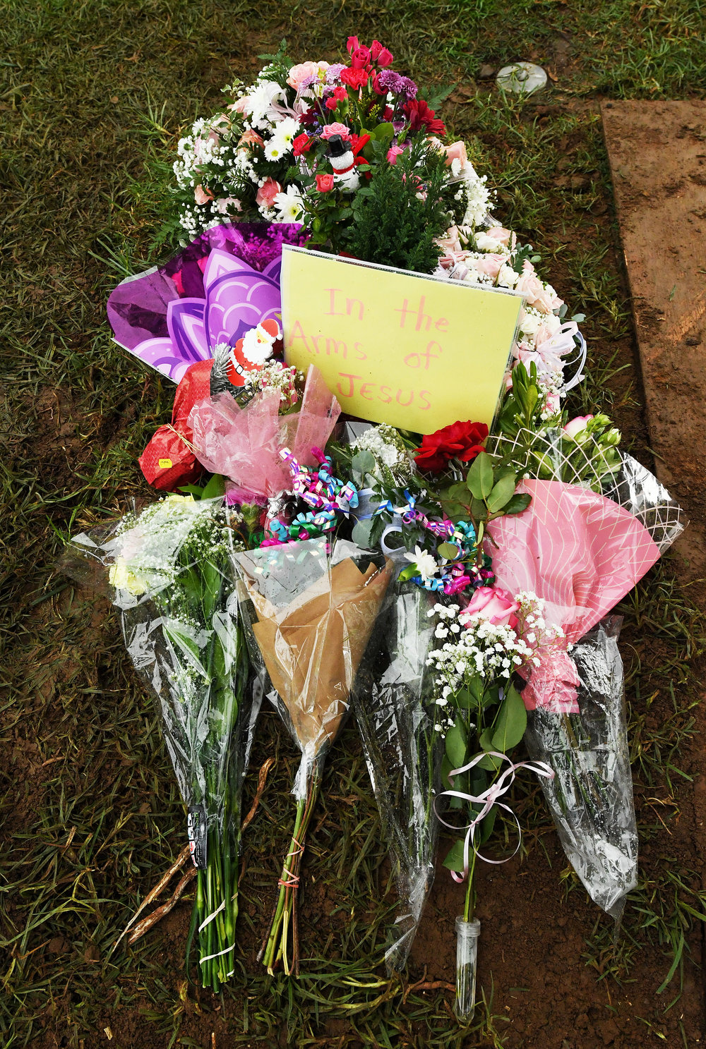 Flowers sit atop the grave of Baby Jane Doe at Sunnyslope Cemetery in Corona, Thursday, December 6, 2018 following the infants burial. The newborn infant was found in a cardboard box near the 15 freeway in Corona in July. Corona police and fire departments along with others contributed to make the funeral possible for the child. Police are still searching for the person or persons responsible.