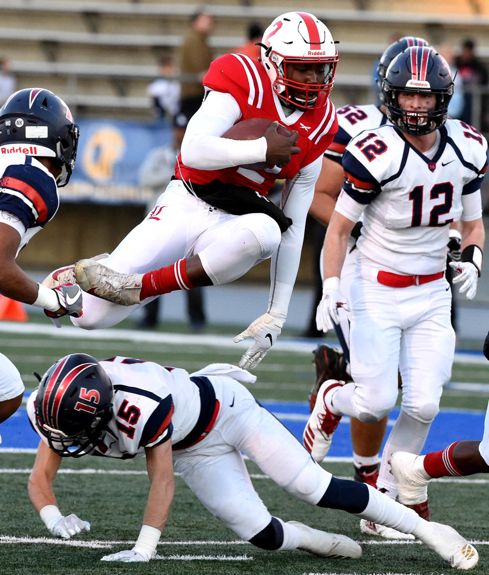 Jalon Daniels #2 of Lawndale leaps for first down against San Joaquin Memorial in the first half of a CIF State Division 2 A Championship football game at Cerritos College on Saturday, December 15, 2018 in Norwalk, California.