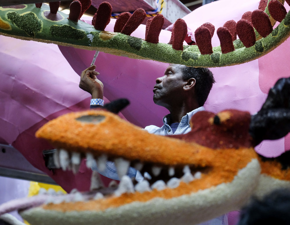 A volunteers works on a flower float for the 130th Rose Parade in Pasadena on Dec. 29, 2018. Better known as the Rose Parade, the festival of flower-covered floats will take place on New Year's Day, Jan. 1, 2019.