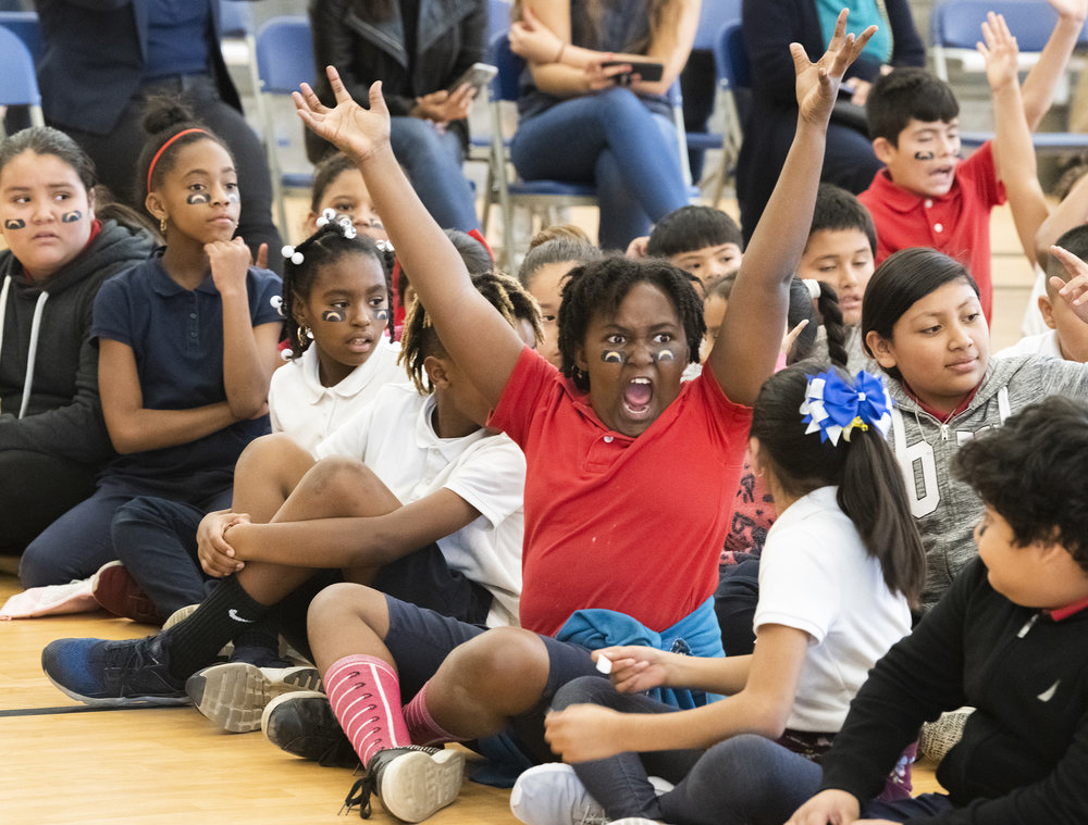 A student reacts at the beginning of the presentation before the Los Angeles Charger players present 150 bikes to 2nd and 3rd-grade students who took part in an essay competition. The bikes were purchased by the team and California Resources Company at Cesar Chavez Elementary School in Long Beach December 4, 2018.