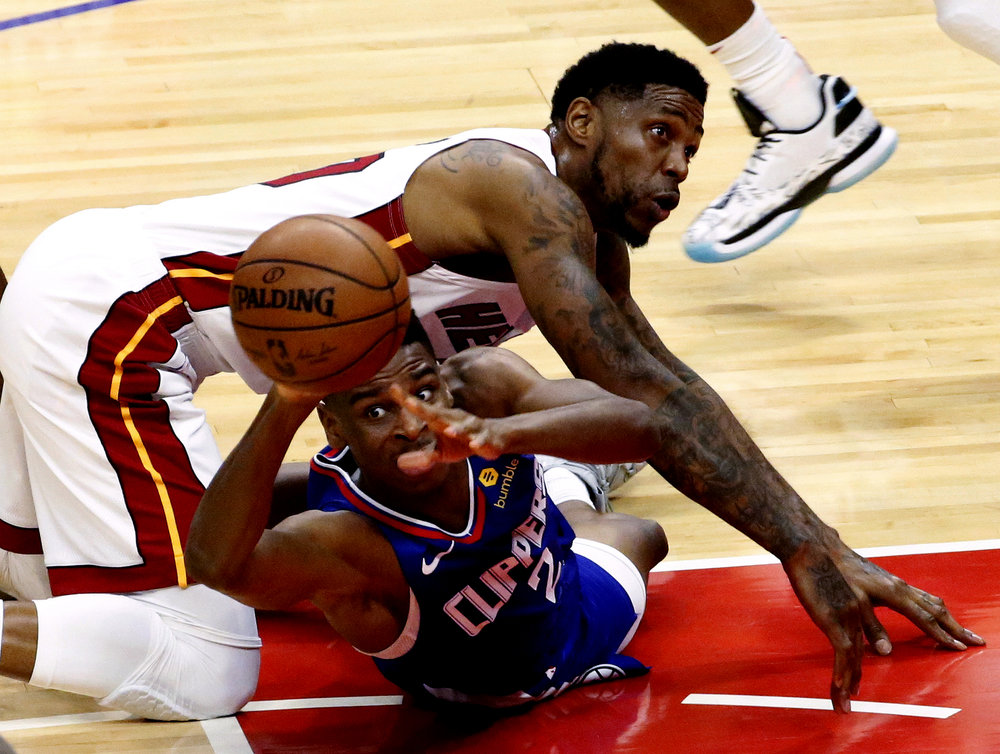 Los Angeles Clippers' Shai Gilgeous-Alexander, bottom, and Miami Heats' Udonis Haslem battle for a ball during an NBA game in Los Angeles on Dec. 8, 2018.