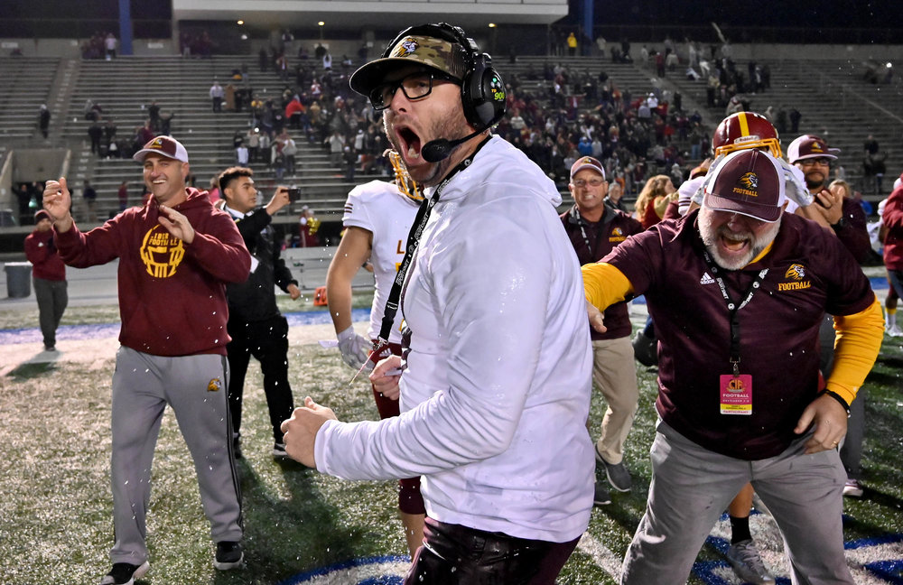 Head coach Ryan Partridge of Liberty celebrates as Liberty defeated Sierra Canyon 19-17 to win the CIF State Division 1 A Championship football game at Cerritos College on Saturday, December 15, 2018 in Norwalk, California.