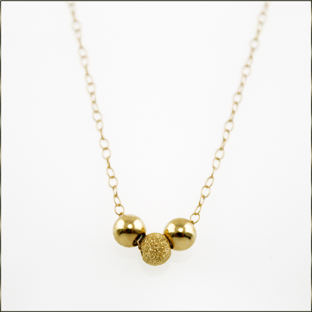 Gold ball necklace.JPG
