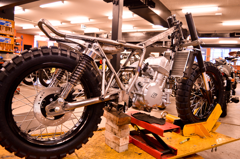 Progress on the Braaap build for the 2015 Throttle Roll. Big thick knobbly tyres have gone on and frame modified to hold the 450cc engine. The beast emerges.