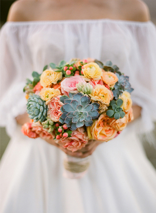 bride with succulent bouquet.jpeg