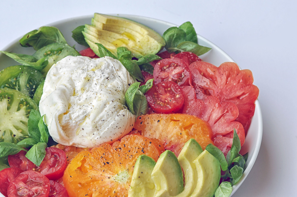 Avocado Caprese Salad with Burrata and Heirloom Tomatoes. A beautiful, vegetarian salad to celebrate summer's best produce.