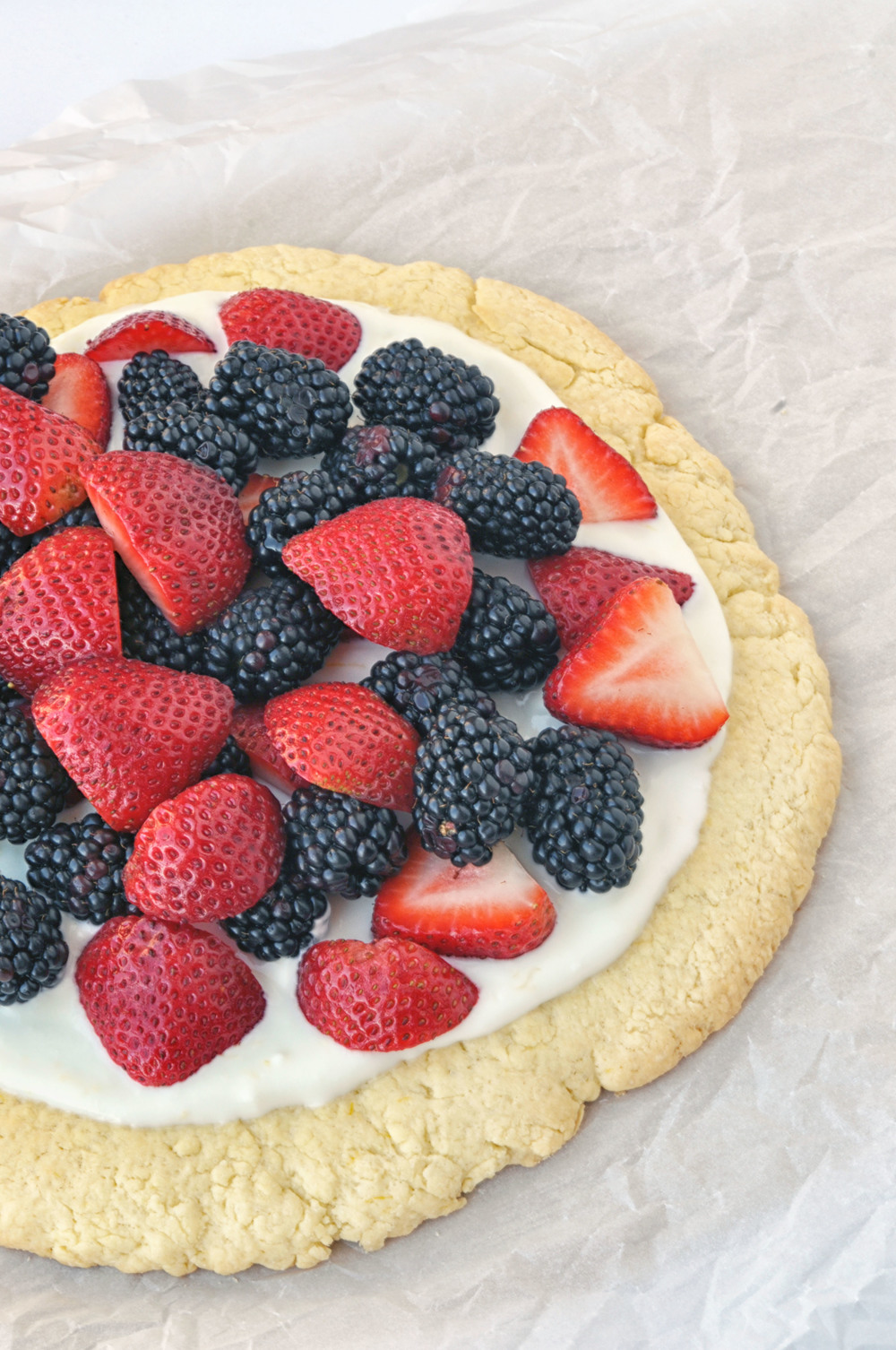 Berry Tart with Lemon Cookie Crust. A lightened up fruit pizza | Shiny Happy Bright