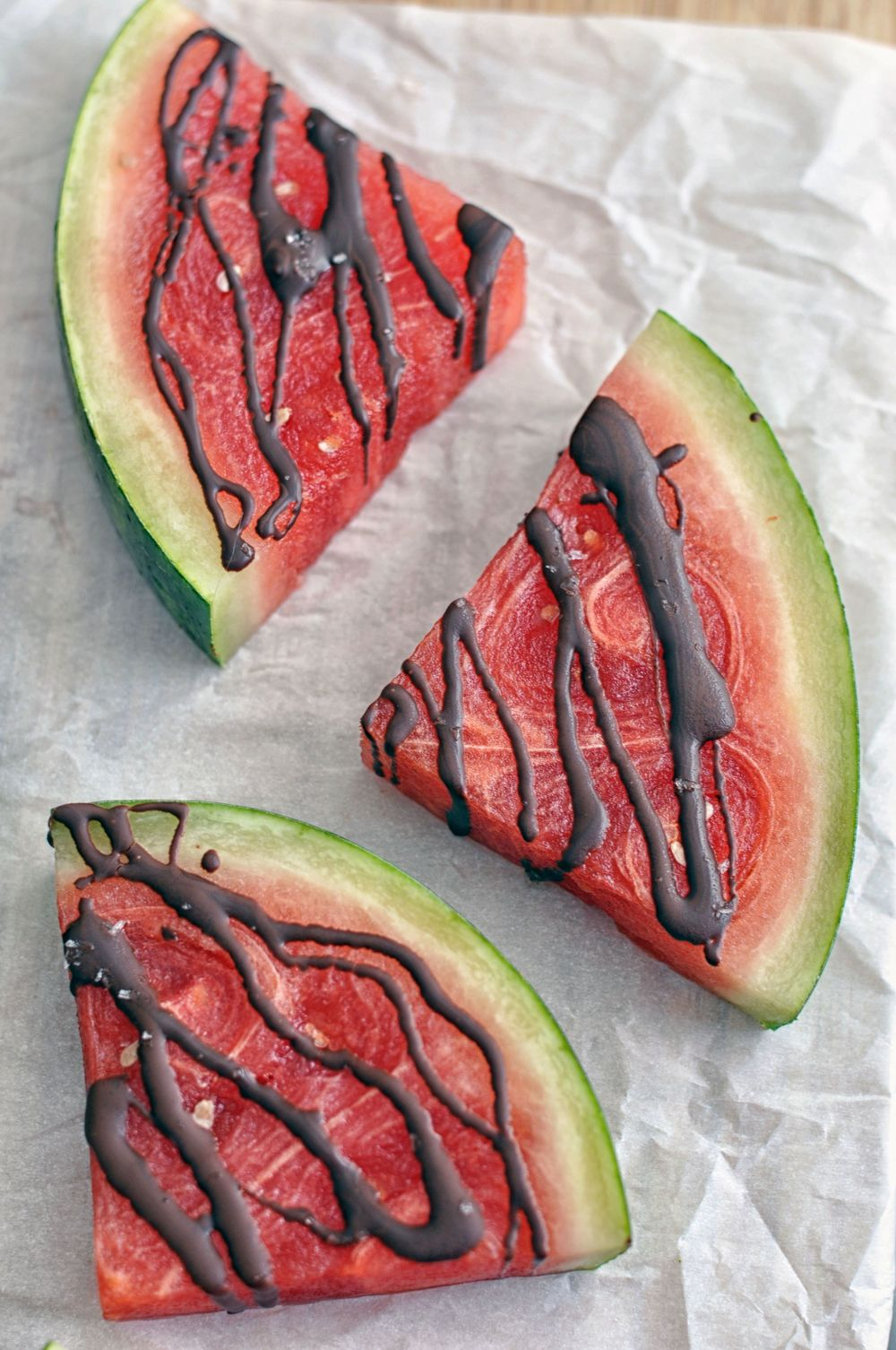 Dark Chocolate Covered Watermelon with Flaky Sea Salt. A healthy and delicious snack or dessert. | Shiny Happy Bright