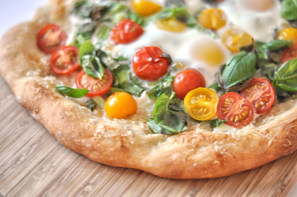 Breakfast Pizza - eggs, tomatoes, green onions, and parmesan on a crunchy pizza crust | Shiny Happy Bright