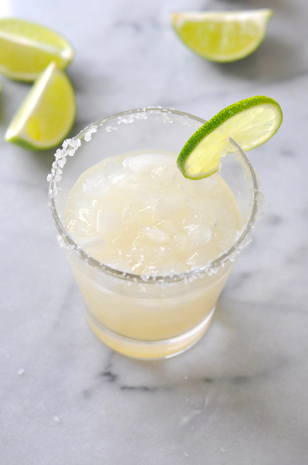 My absolute favorite margarita recipe! This ginger margarita is delicious and kicky! It's a perfect happy hour drink. | Shiny Happy Bright
