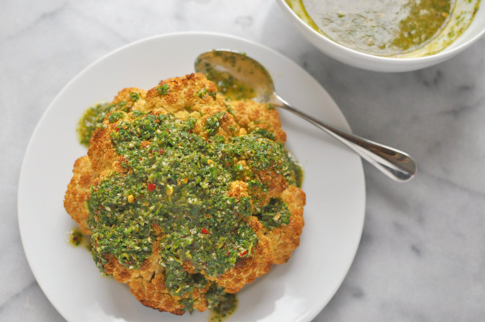Whole Roasted Cauliflower with Chimichurri Sauce  - a delicious vegan side or main dish | Shiny Happy Bright