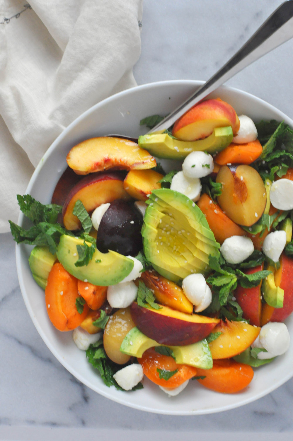 Summer Stone Fruit Salad with peaches, plums, apricots, avocado, and mozzarella - a beautiful celebration of summer produce | Shiny Happy Bright