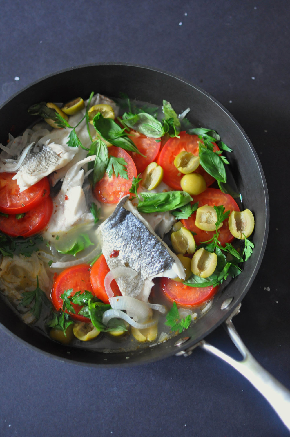 Poached sea bass recipe with tomatoes, olives, and onions | Shiny Happy Bright