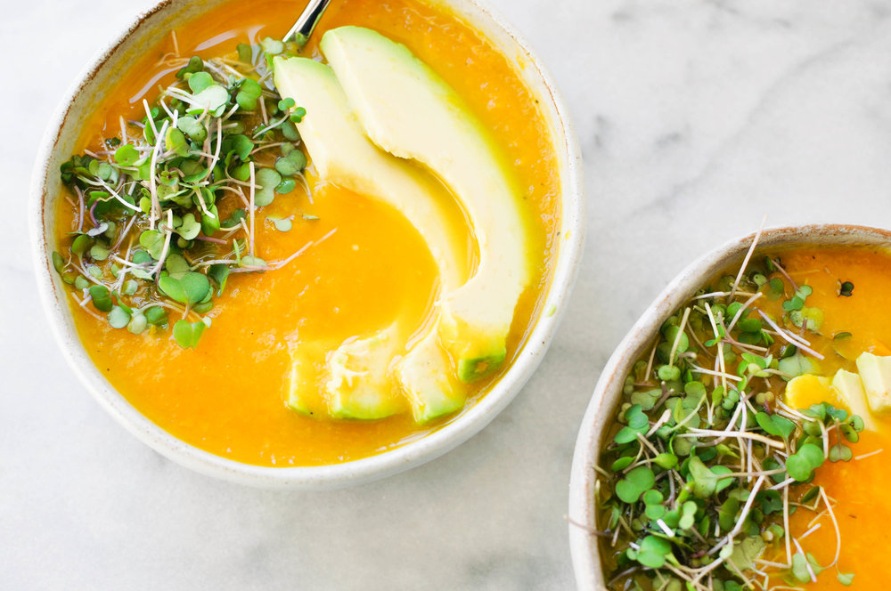 Bell Pepper, Butternut Squash, and Carrot Soup. A hearty, healthy vegan soup - garnished with microgreens and avocados | This Healthy Table