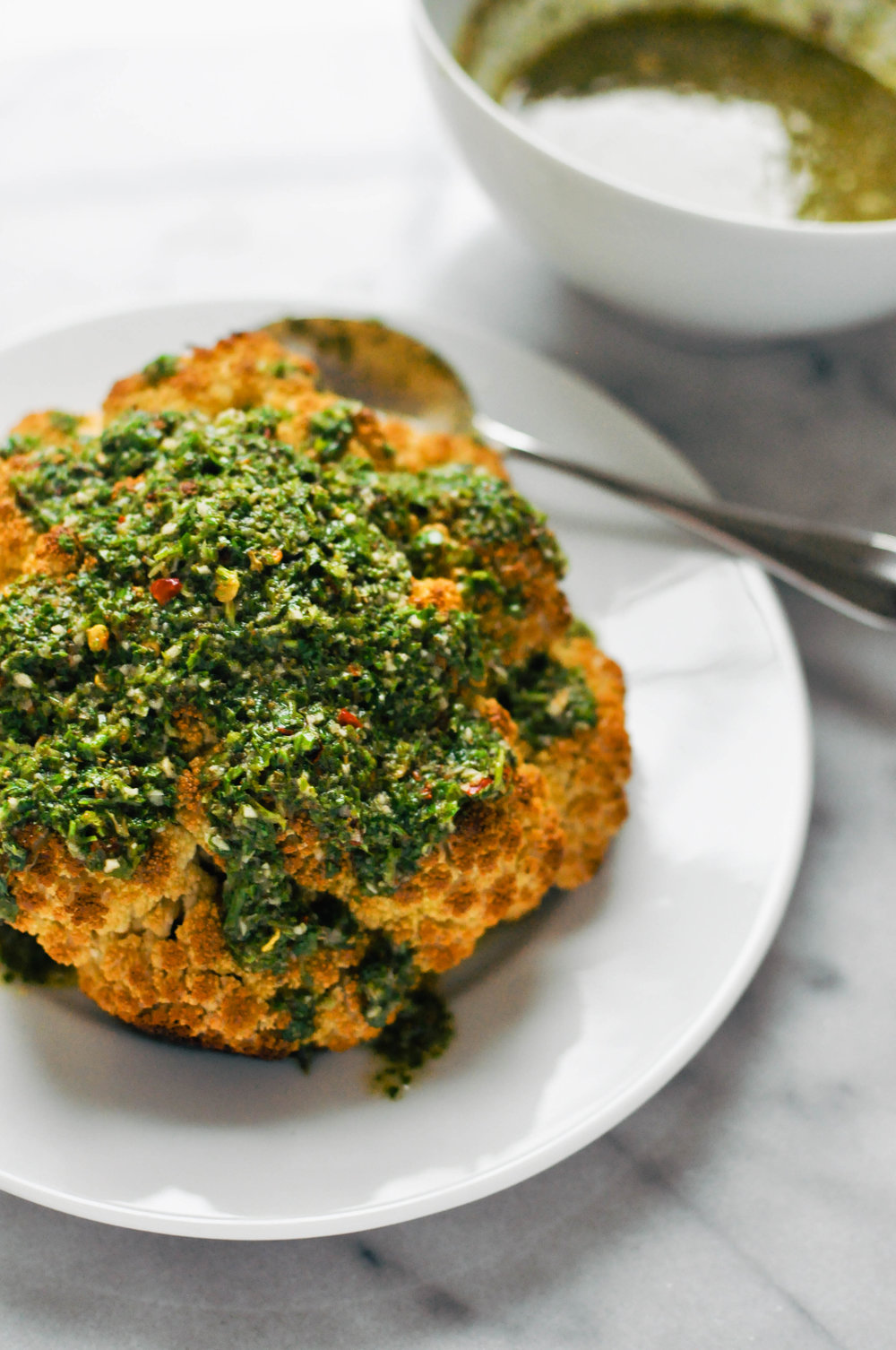 Whole Roasted Cauliflower with Chimichurri Sauce  - a delicious vegan side or main dish | This Healthy Table