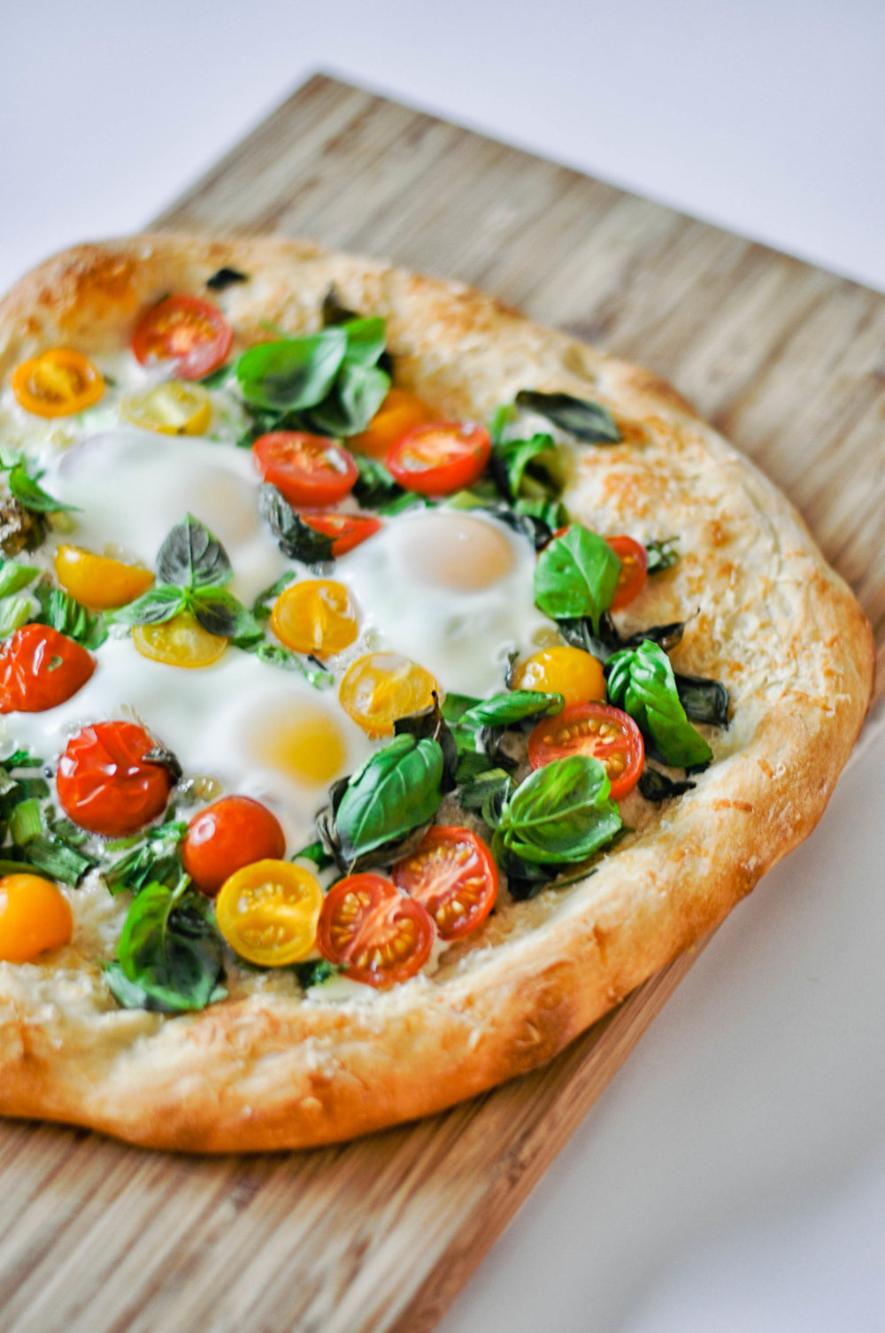 Breakfast Pizza - eggs, tomatoes, green onions, and parmesan on a crunchy pizza crust | This Healthy Table