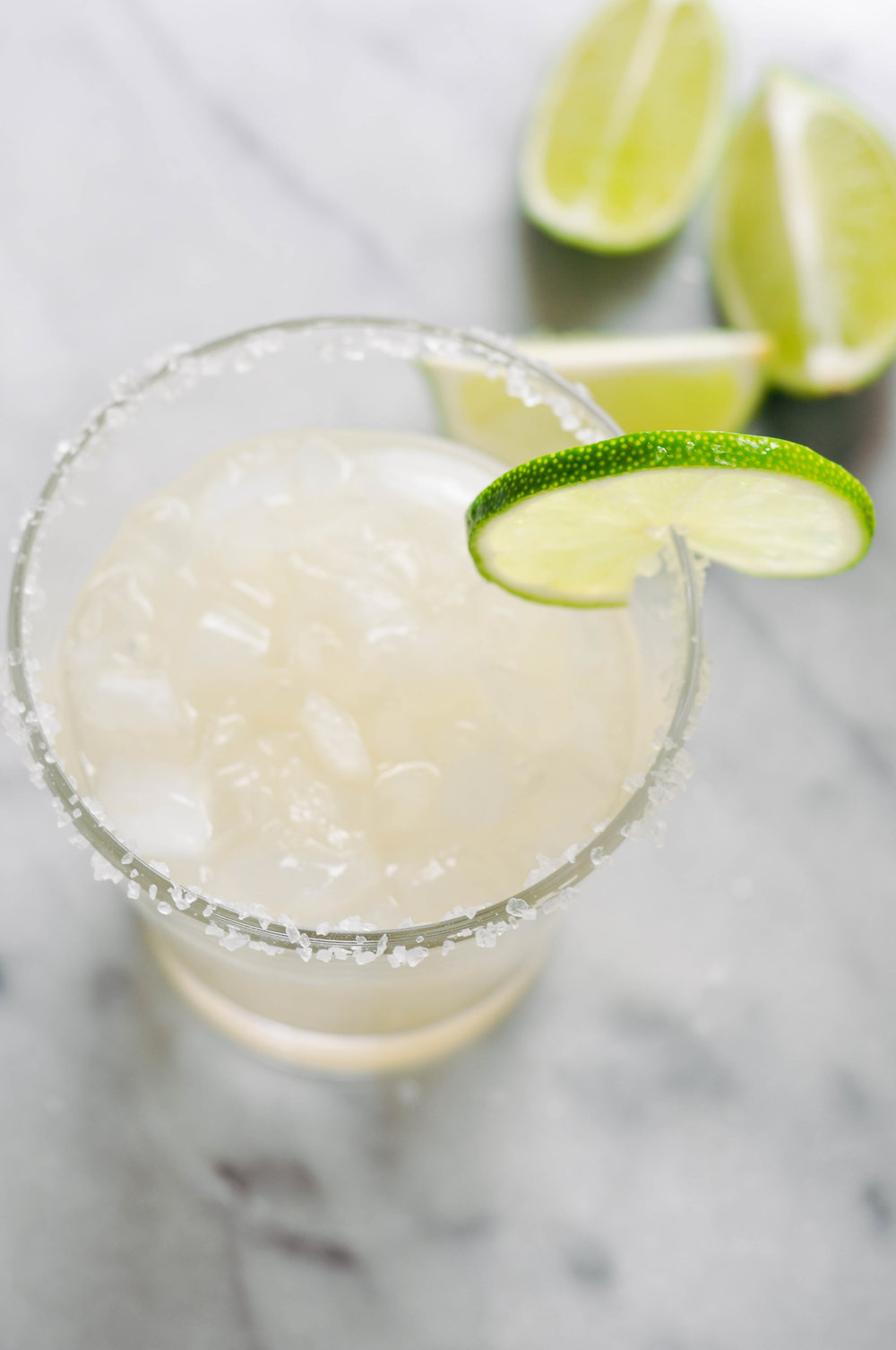 My absolute favorite margarita recipe! This ginger margarita is delicious and kicky! It's a perfect happy hour drink. | This Healthy Table