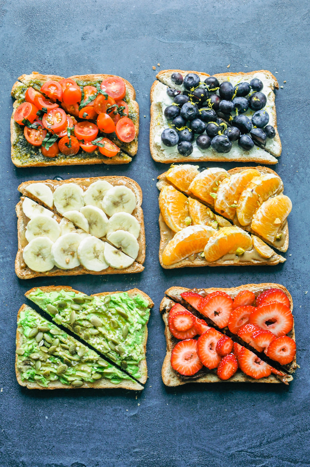 6 kinds of toast! Tomato & pesto, almond butter & banana, avocado & pepitas, goat cheese & blueberry, sunflower seed butter & oranges, chocolate spread & strawberries.