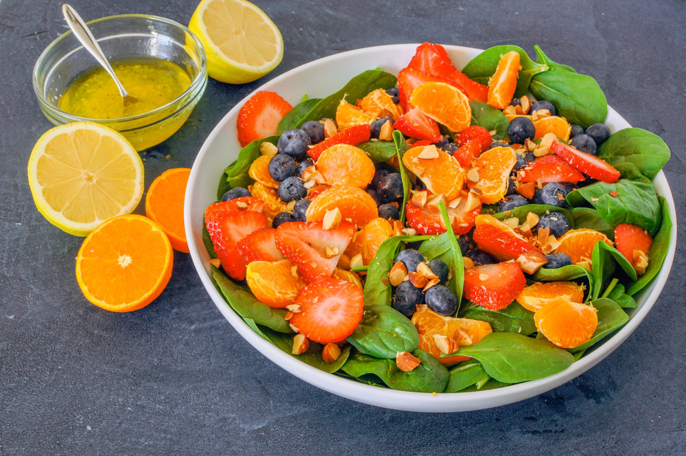 This energy boosting salad with citrus, berries, and spinach is easy, refreshing, and bright.