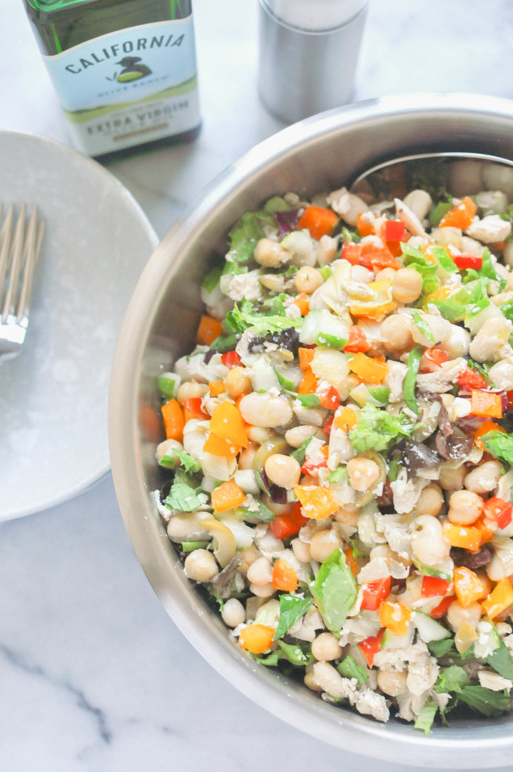Easy Mediterranean Chicken Salad - This Mediterranean chicken salad is everything you need in an easy, quick weeknight meal. It's full of delicious flavors - artichokes, bell peppers, beans, chickpeas - it has everything.
