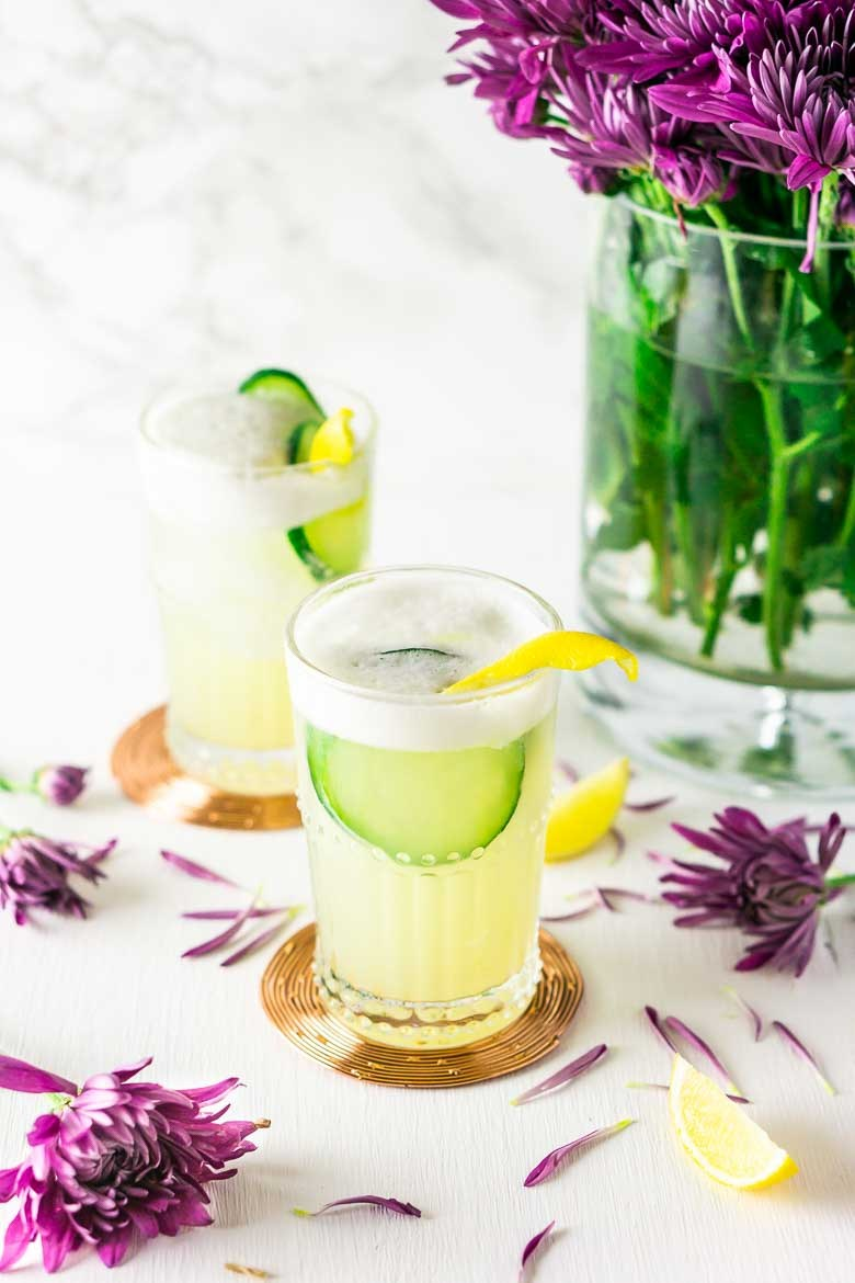 Cucumber Lavender Gin Fizz from Burrata & Bubbles - With fresh cucumber juice, lavender simple syrup and lemon, this cucumber-lavender gin fizz is refreshing and perfect for those patio nights.
