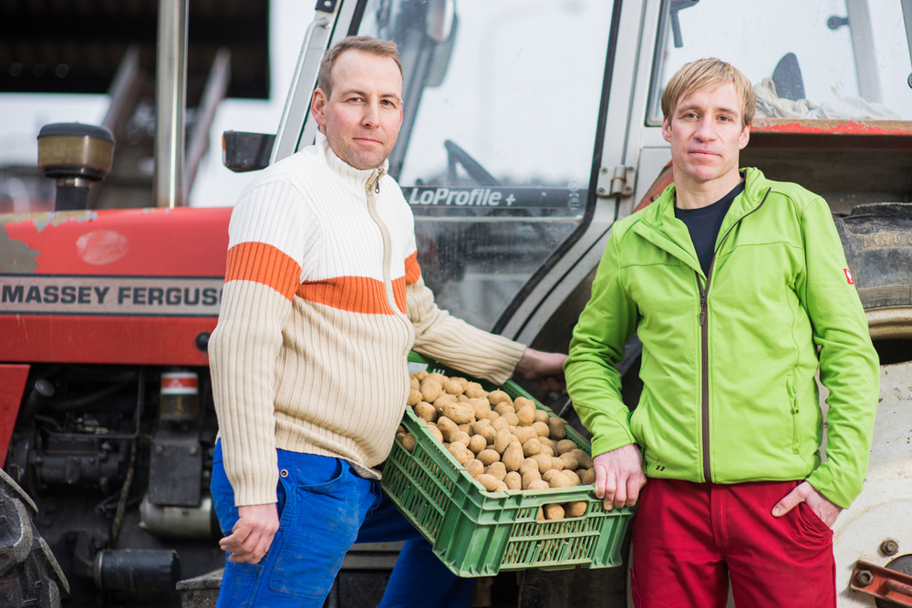 Potato Farmers Pirmin and Fredi Umbricht.To their right is an Elinchrom Quatra shot through a trifold umbrella, on an overcast day. Nikkot Ai-S85mm st 1.4 or 2.0