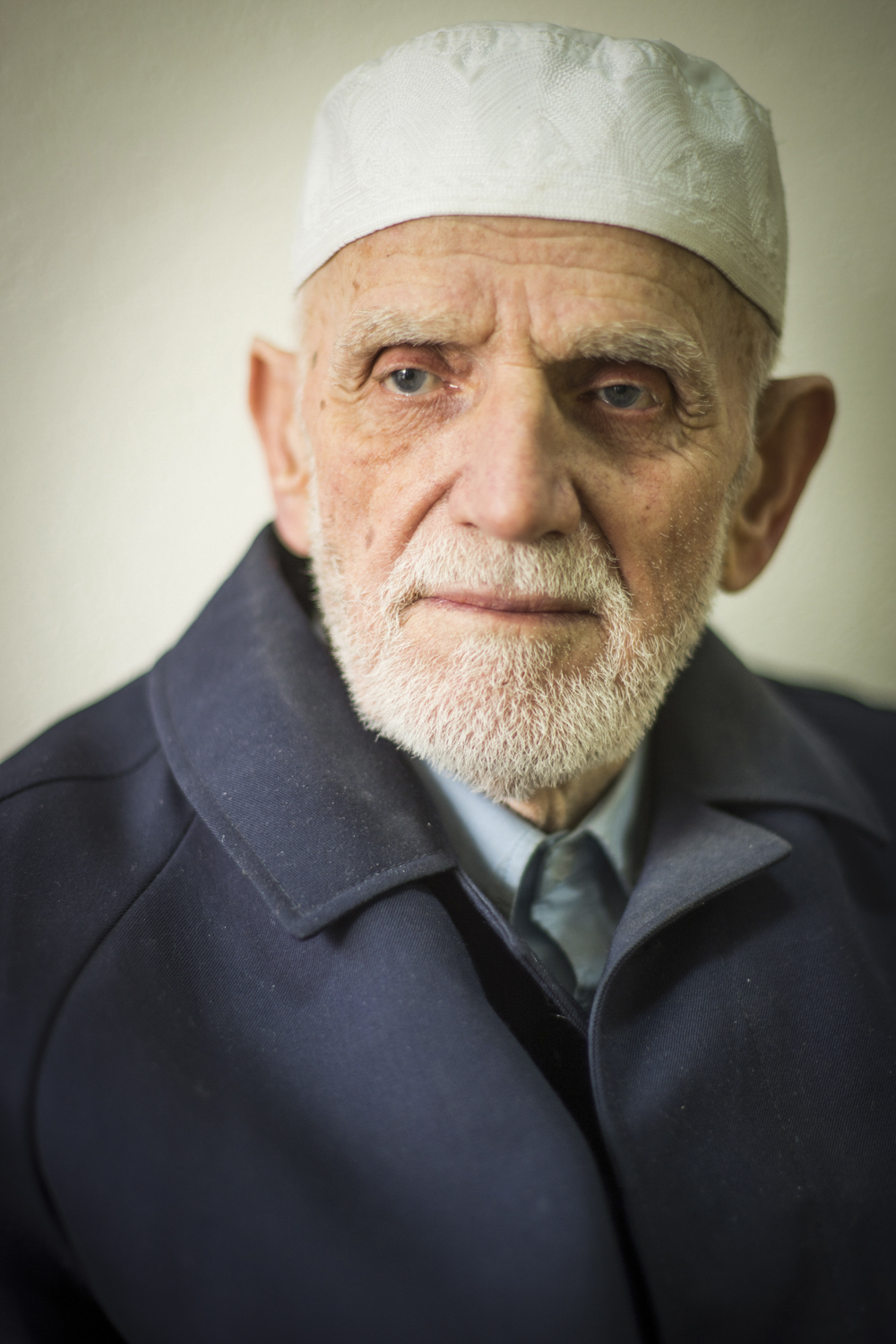 83 year old Magjun Kuqi sitting in a tea house of one of Pristina's many Mosques. Shot with the A7ii and 85mm Ai-s at 1.4