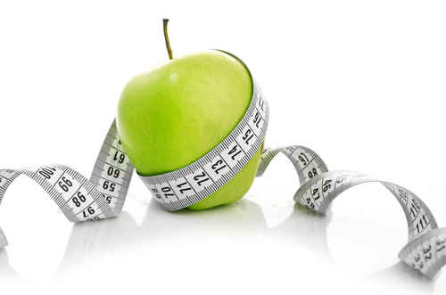 stock-photo-measuring-tape-wrapped-around-a-green-apple-as-a-symbol-of-diet-111792323.jpg