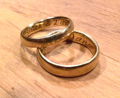 14K gold rings, engraved with the couples name, pictured after one year of wear. Click to go to Wedding and Engagement.