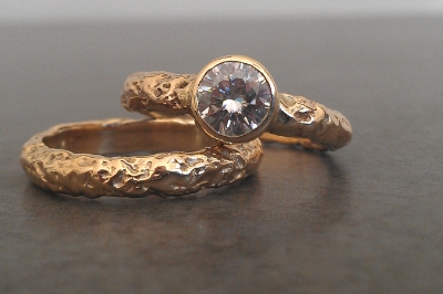 A 14K gold wedding and engagement set.