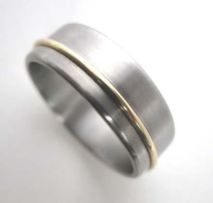 Titanium band with 18K gold wire.
