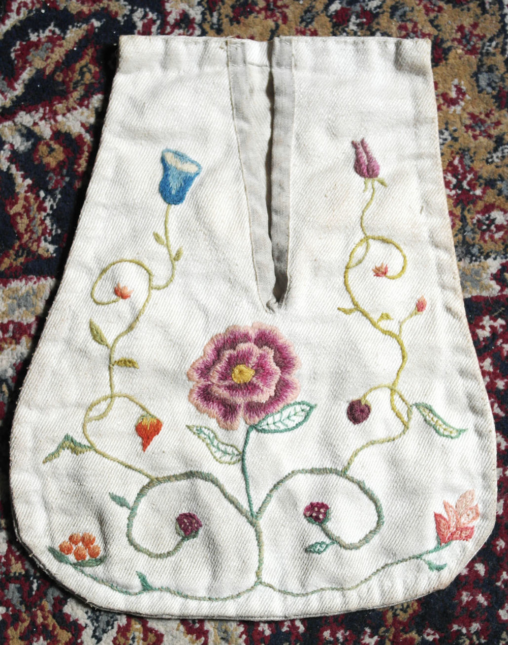 An shot of a reproduction 18th century embroidered pocket, by Aurora Simmons. Crewel wool on linen.