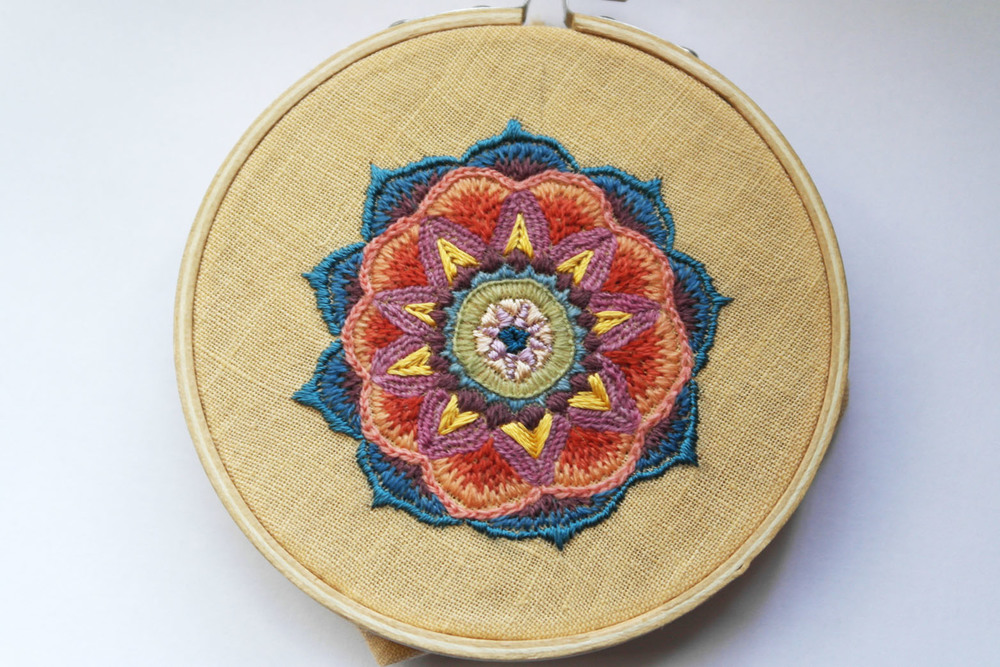 Embroidered mandala by Aurora Simmons with silk and crewel wool.