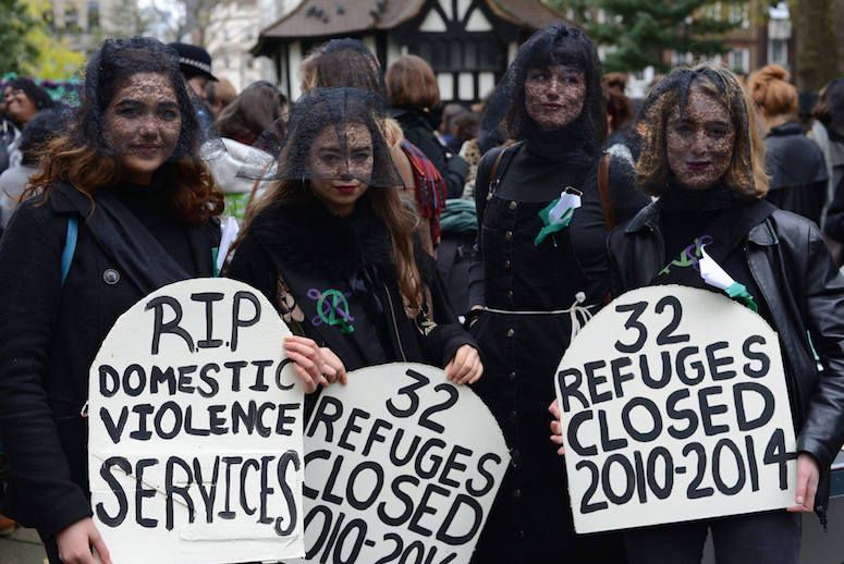 Sisters Uncut held a funeral themed march through London to commemorate and draw attention to the women killed by partners and the high number of support services cut since 2010.