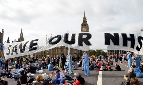 Protestors blocked Westminster Bridge to protest the selling off of the NHS to private companies