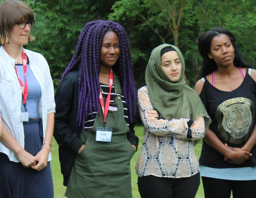Image Description: Jess, Samia, Aamirah and Rosaleen from Bootcamp 7 stand in a line outside at Campaign Bootcamp. Samia is smiling.